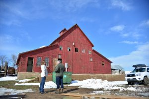 Larimer County Commissioner Tom Donnelly, right, and Larimer County Department of Natural Resources Open Lands program manager Kerri Rollins pictured in front of the iconic Malchow barn just off highway 287 southwest of Berthoud during a tour of the property on March 24. John Gardner / The Surveyor