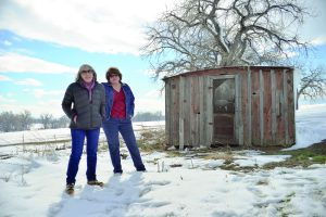 Peggy Malchow Sass, left, and sister Jean Malchow stand next to an 1800s beet shack that remains on their family farm southwest of Berthoud. The sisters agreed to sell the property with associated water rights to Larimer County Open Lands Department in an historic agriculture land preservation deal. All photos by John Gardner / The Surveyor