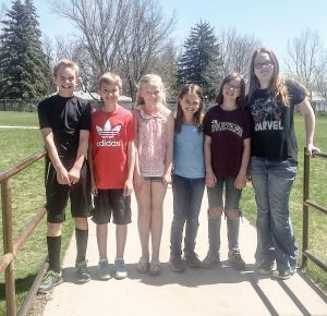 Six Berthoud El fifth graders were selected for publication in the 2016 Youth American Poetry Digest. The students wrote haiku poems on subjects of their choice. From left to right: Bobby Holt, Kaleb Johnson, Kelsi Thoren, Sophie Feller, Liberty Markey and Madelyn H. Katie Harris / The Surveyor