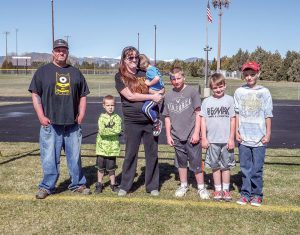 Proceeds from the 2016 Alex Sabados Day of Kindness benefited Jacob Young, a Berthoud Elementary kindergartener who was diagnosed with Leukemia two years ago. He is pictured with his family, from left to right: Robert Sr., Jacob, Amber, Nicholas, Robert, Gracin, and Matthew. Katie Harris / The Surveyor
