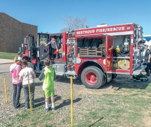 . The Berthoud Fire Department was on scene Saturday morning, and Jacob Young, along with his four brothers, were thrilled to receive fire fighter hats and to climb aboard the fire truck. Katie Harris / The Surveyor