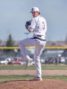 Berthoud senior Issac Bracken prepares a pitch during a game in March at Jack Sommers Field at Berthoud High School. Bracken has been a dominate pitcher from the mound this season and even threw a complete game no-hitter against Erie on April 14. Bracken has also earned All-American honors this season. John Gardner / Surveyor file photo