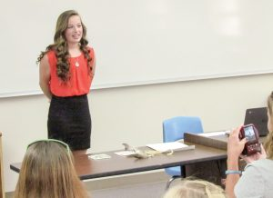 Taitlyn Harrigfeld shares her memories of TMS during her year-end presentation. Photo by Bob McDonnell Surveyor photo
