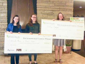 From left to right: Berthoud High School students Gabrielle Mizer, Renee Raak, and Emily Casper receive the checks after placing first and second in the Northern Colorado Caring for Our Watersheds contest. Courtesy photo