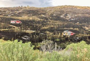 Quick response saves homes in 30-acre fire