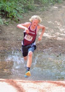 Berthoud sophomore Siler Stein crosses a creek at the Cheyenne Mountain Stampede in Colorado Springs, Friday.  courtesy of Karen von Seggern