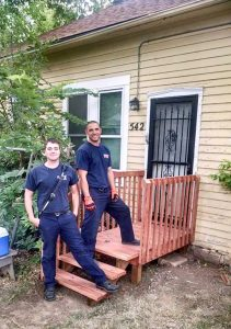 Berthoud firefighter Max Peacock, left, and engineer Travis Cole pose for a photo on Susan Chapman's front porch, which the two, along with Lt. Dan Forbis, replaced after Chapman was taken to the hospital to receive treatment for a medical condition on Tuesday, Aug. 23. All photos courtesy of Dan Forbis / The Surveyor