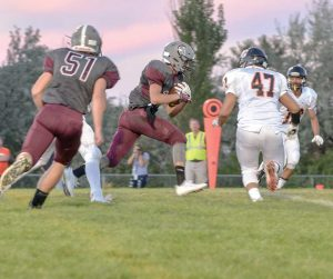 Berthoud running back Wyatt Woodrick (15) charges to the goal line during the first quarter of the Berthoud versus Greeley Central game at Max Marr Field at Berthoud High School on Sept. 3. Woodrick took the ball to the 1-yard line and set up a Brock Voth touchdown, the Spartans' first of the game. John Gardner / The Surveyor