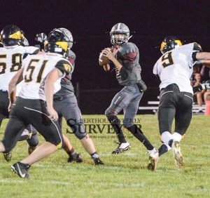 Berthoud quarterback Brock Voth looks downfield for a receiver during the second quarter of the homecoming game versus Thompson Valley at Max Marr Field on Sept. 30. John Gardner / The Surveyor