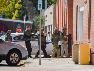 Larimer County SWAT members enter the Subway with a K-9 deputy Tuesday to clear the building of a possible third suspect in the attempted burglary. Two local men were arrested in connection with the incident.  John Gardner / The Surveyor