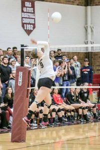 Berthoud's Julie Ward goes for a kill against Windsor in the Spartans' fi nal regular season game at Berthoud High School on Oct. 25. Photo by Paula Megenhardt