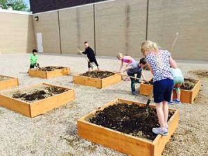 Students work on the Ivy Cares Club gardens at Ivy Stockwell Elementary School.  Photo by Katie Harris / The Surveyor