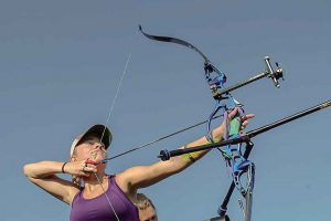 Berthoud High School senior Kira Bollar pictured with her bow at an event. She was the Rocky Mountain State Champion in 2015 and 2016. She currently holds five state records – two of which were the breaking of her own record this past year. She is the number-one ranked archer in Colorado and currently ranked 14th nationally for the United States Archery Team (USAT). Photo courtesy of Kim Bollar