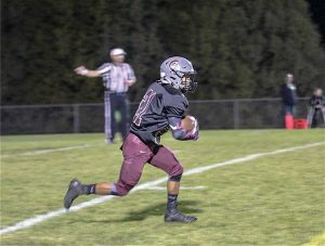 Berthoud Spartans wide receiver Miguel Sarmiento breaks free and runs the ball to the end zone for a touchdown during the final minutes of the game. Tiffany Rafferty / The Surveyor