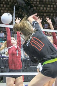 Berthoud's Sophie Kathol goes up for a block with the help of teammate Shay Pierick during the first round contest against No. 1 seed Lewis-Palmer at the Denver Coliseum on Nov. 11. The Spartans lost the contest 3-0, and it was the second year in a row that they drew No. 1 seed in the 4A state volleyball tournament. Paula Megenhardt / The Surveyor
