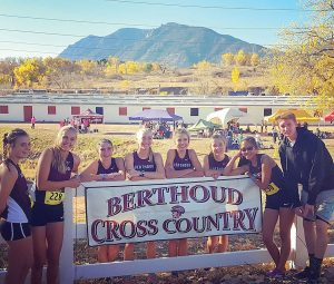 Berthoud Weekly Surveyor cross county athletes of the year: Maycee White and Josh Doyle, pictured with the girls cross country team at the state competition in Colorado Springs.