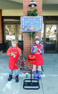 Matt Harris, 7, and Haley Harris, 9, volunteered to be Salvation Army bell ringers at Hays Market in Berthoud. The organization is in need of additional volunteers this holiday season. Katie Harris / The Surveyor