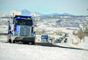 A convoy of friends and customers of George Wood, owner and operator of Heavy Duty Truck Repair, drive by Wood's home west of Berthoud and honk on Saturday, Jan. 7. The convoy included 31 semi-trucks. John Gardner / The Surveyor
