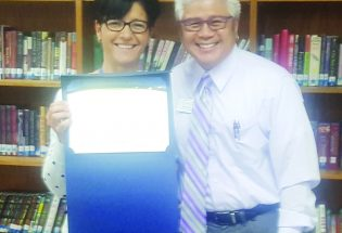 Turner's Merri Hocker receives Award of Excellence for her work as school registrar