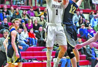 Spartan boys split last two conference games