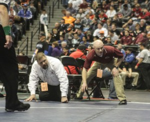 Coaches-Will-Carron-and-Scott-Pickert-watch-intently-as-Matthew-Bailey-wrestles-in-the-semis.